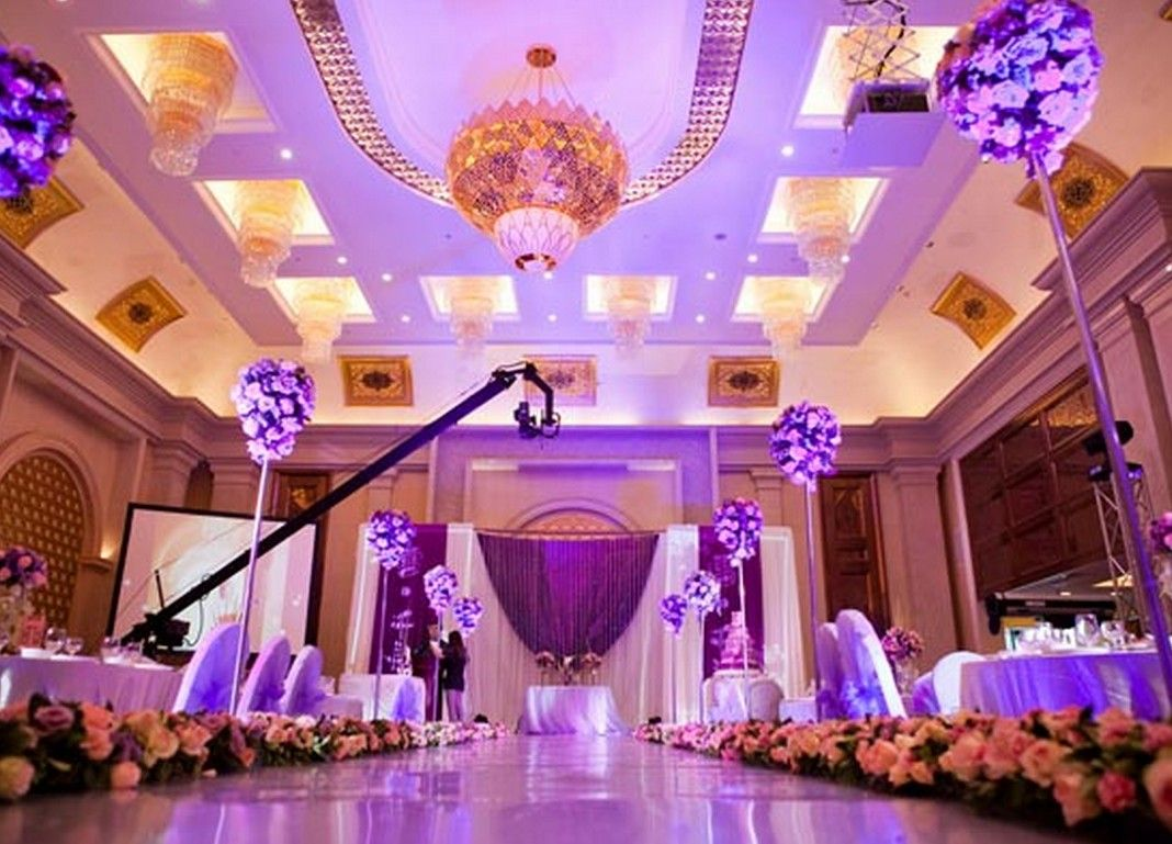 Wedding hall decorations green wedding theme purple for Wedding hall decoration photos