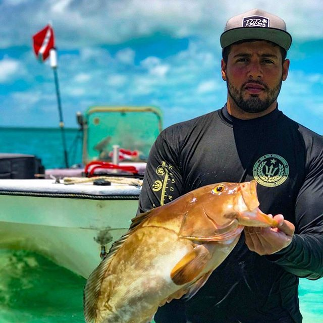 Today is a good day! Shoutout to @el_solocholo for the rad shot of him in the Rulersleeve 2.0 Grouper Shirt and Signature #snapback with a fatty red grouper! Find these products and more at redrumintl.com  or at our retailers tagged in the photo!  #redrumintl #redrum #diving #fishing #boarding #living #spearfishing #fishingshirts #rulersleeve #grouper #