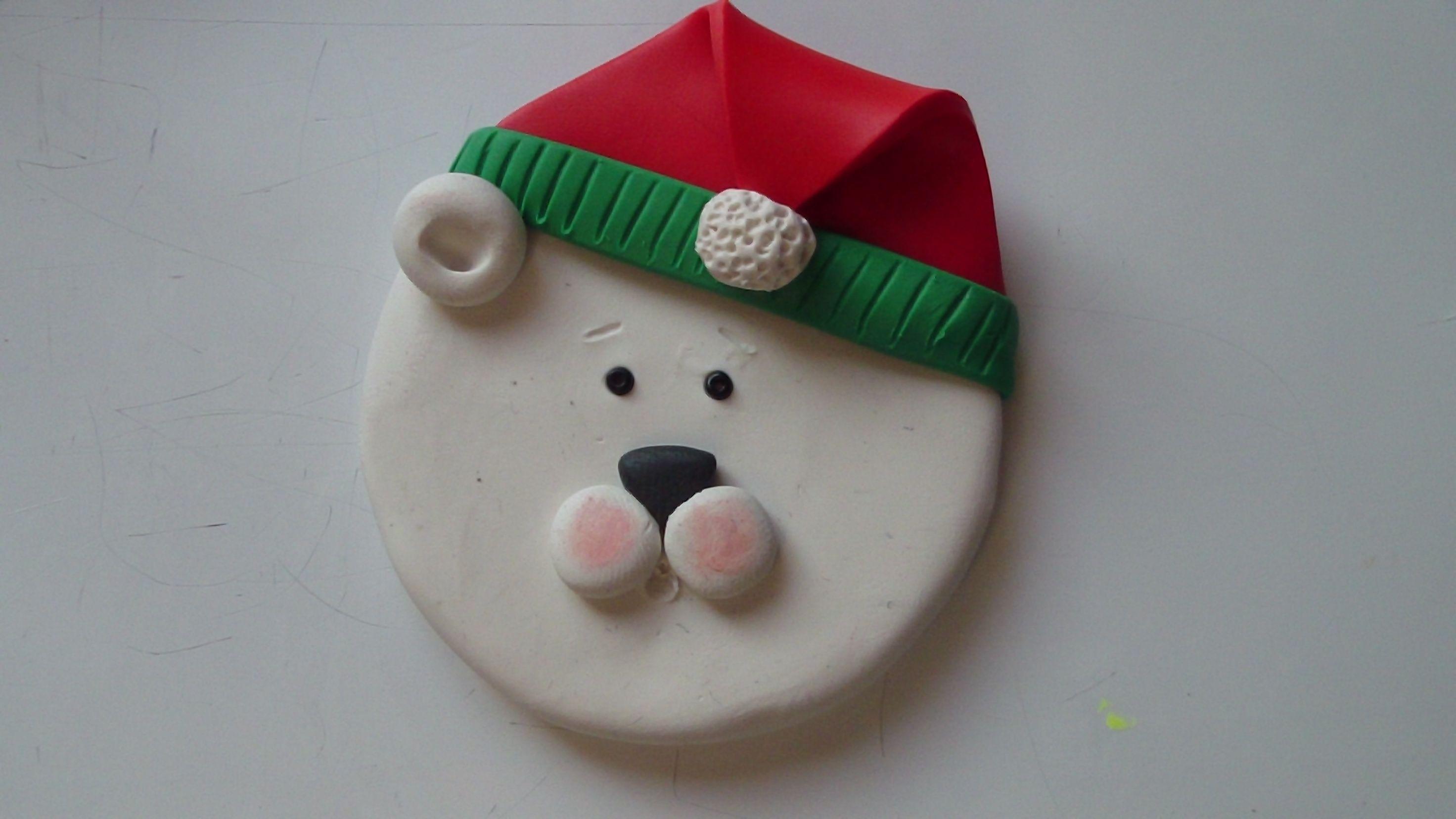 Handmade polymer polar bear ornament with mirror on back.