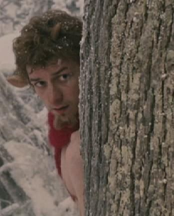 James McAvoy as Mr. Tumnus in The Chronicles of Narnia: The Lion, the Witch and the Wardrobe -The faun hiding behind the tree. (2005)