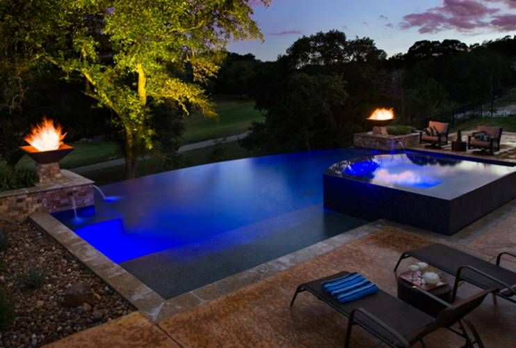 Raised black tile pool and spa with infinity edge on all sides. Very ...