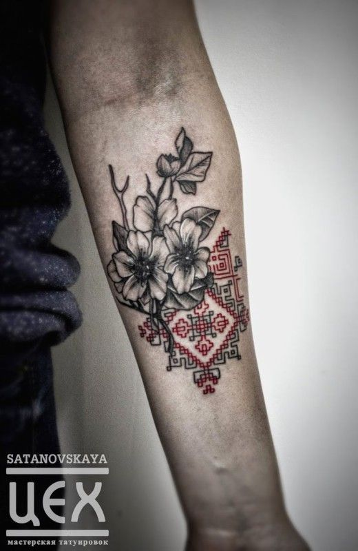 Mixing traditional embroidery with flowers tattoo by