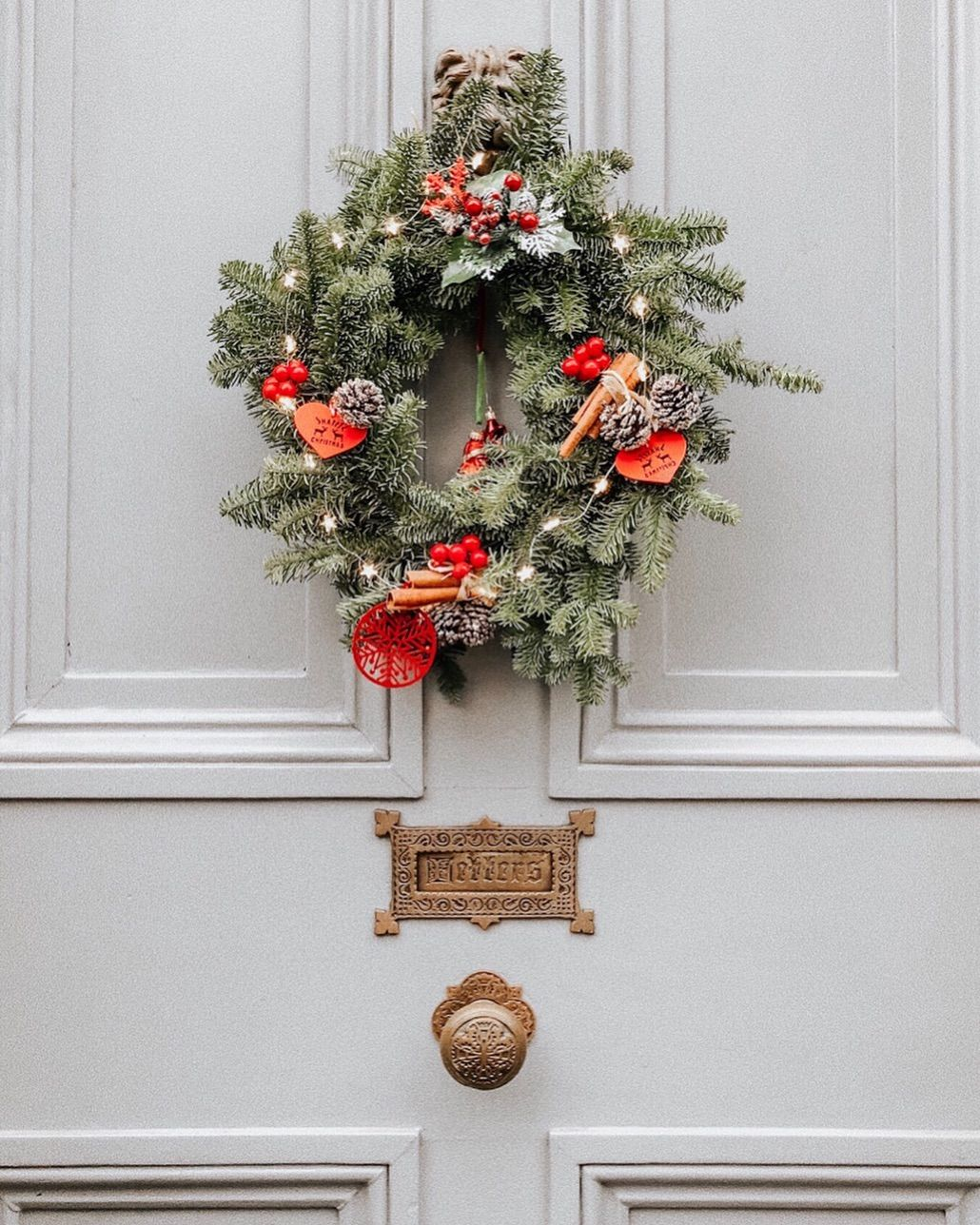 Christmas Wreath On A Pale Grey Door Festive Home Decorations