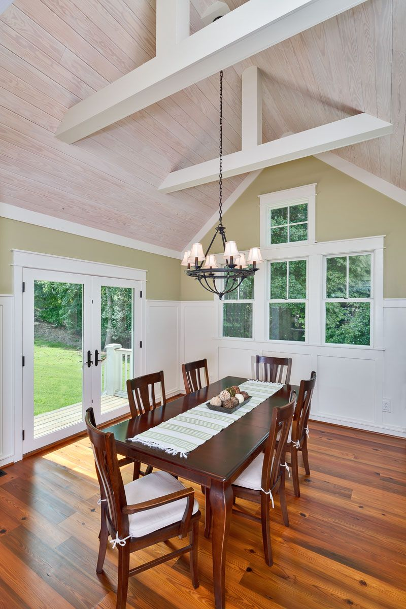 This dining room features a vaulted whitewashed tongue and for Vaulted ceiling with exposed beams