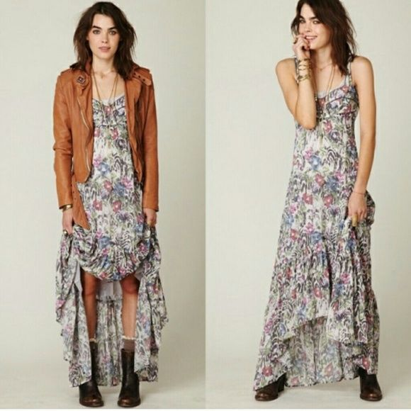 Free People asymetrical maxi dress 100%rayon, soft and flowy, asymetrical ends, cute pattern.  Dearly loved. Way to small now. Slightly sheer but not see through. Bust 14 inches, has a small adjustable platform in the back. Length from shoulder to the longest point 54 inches. Free People Dresses Maxi