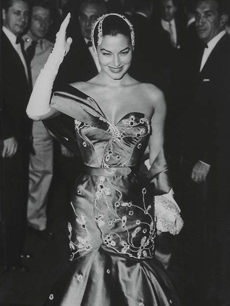 Ava Gardner wearing a crimson gown by Fontana and a headpiece that is in the AG Museum now ( The Barefoot Contessa premiere, 1954)