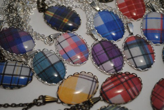 One custom tartan necklace set in an 18x25 metal lace setting on a matching 16-20 adjustable chain, handmade by me. Comes with the option of two