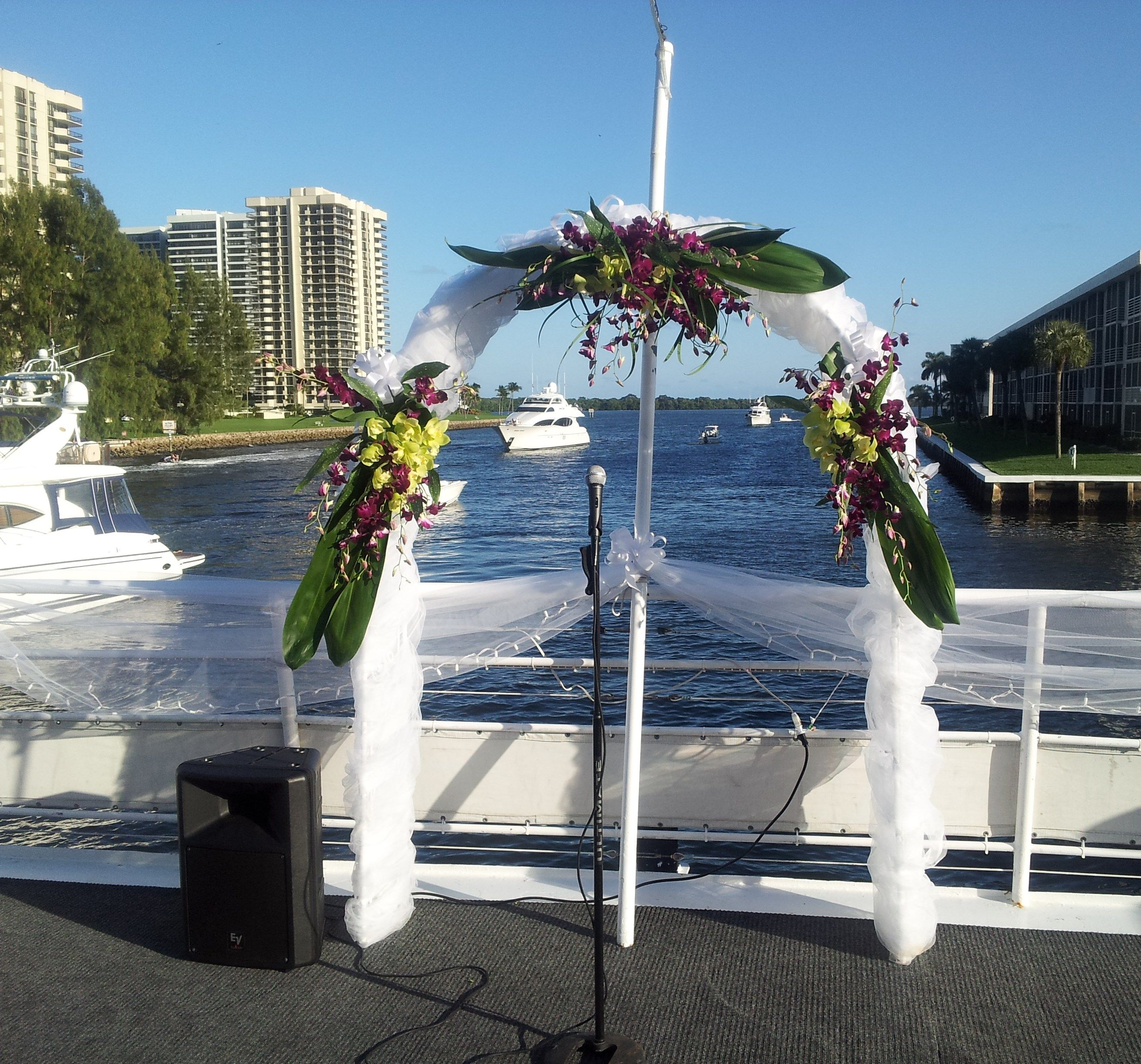 Yacht wedding decorations  Tropical arch arrangement w orchids on The Catalina Yacht  Wedding