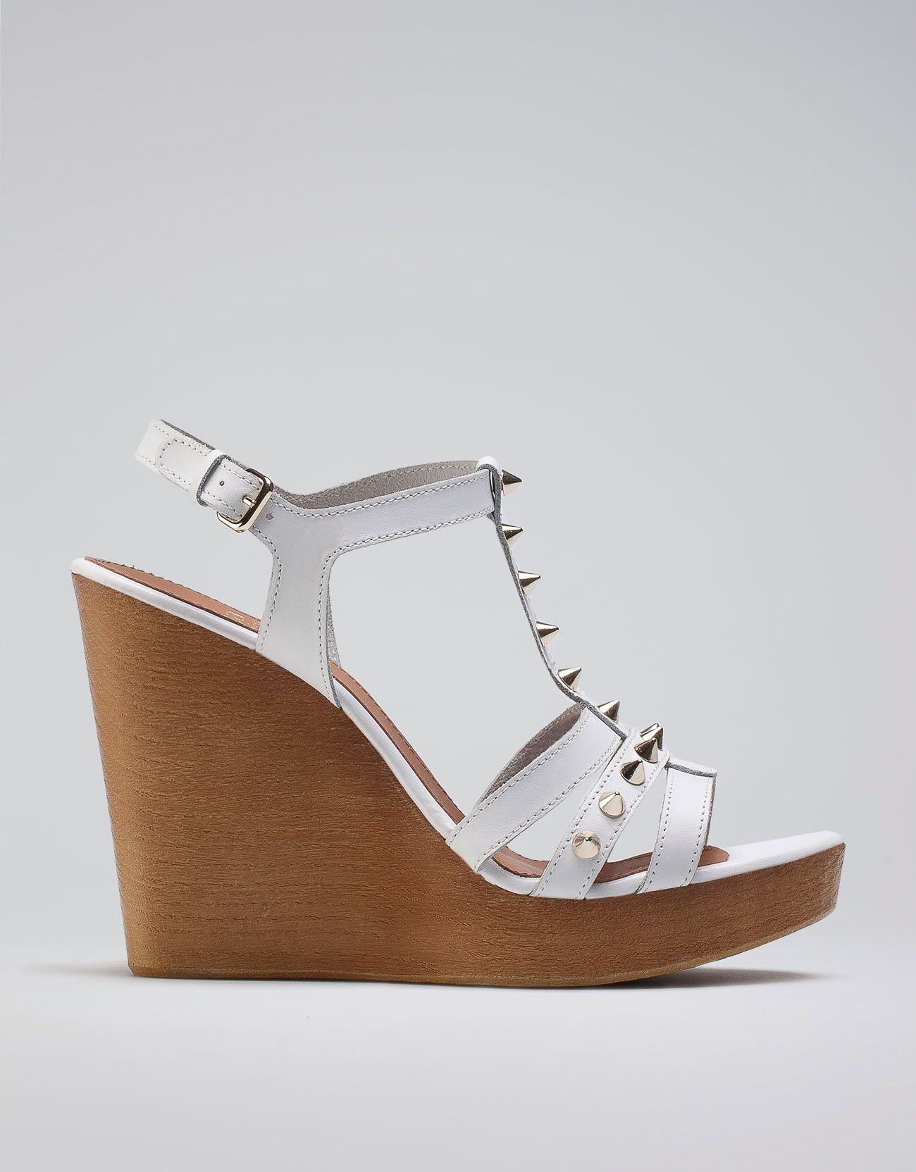 White leather wedges with silver studs