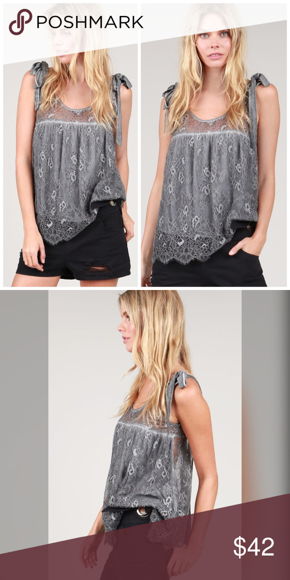 Eyelash laced top with shoulder tie detail! Team favorite this amazing tie strap tunic has a swing cut with a sheer back and lined front - beautiful eyelash detail lace in deep charcoal Tops