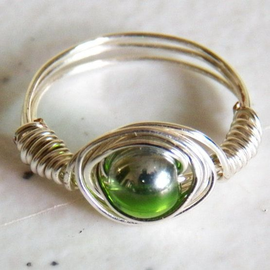 Silver Wire Vortex Ring with Spinning Green and Silver Glass Focal Bead by EleganceByLadyLee on Etsy