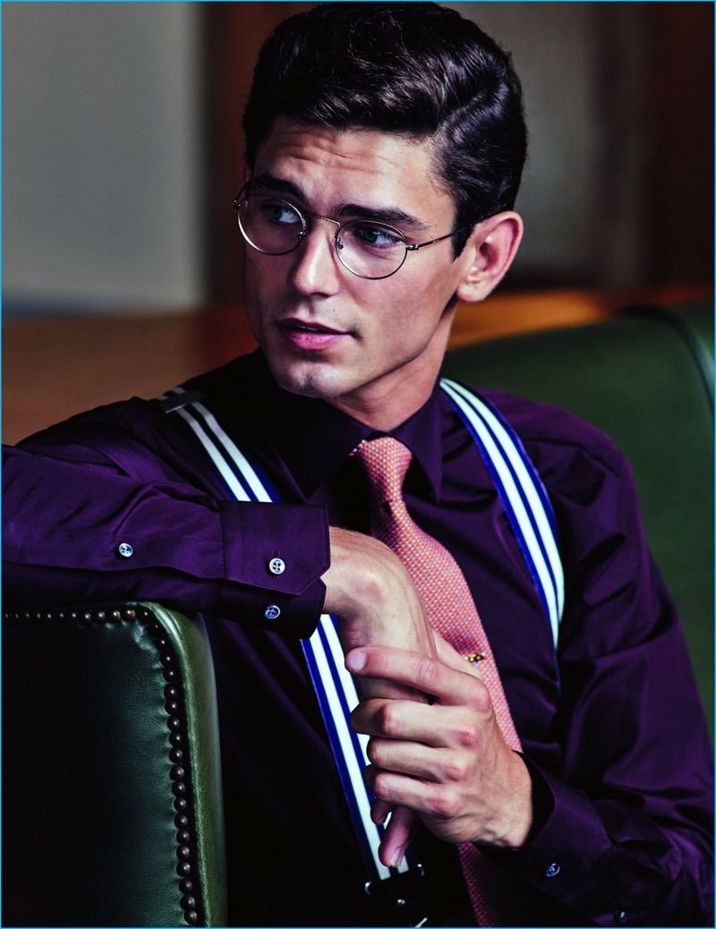 981c24b97 Model Arthur Gosse wears a burgundy Boss by Hugo Boss shirt, with a Hermes  tie, Hackett London suspenders, and Giorgio Armani glasses.