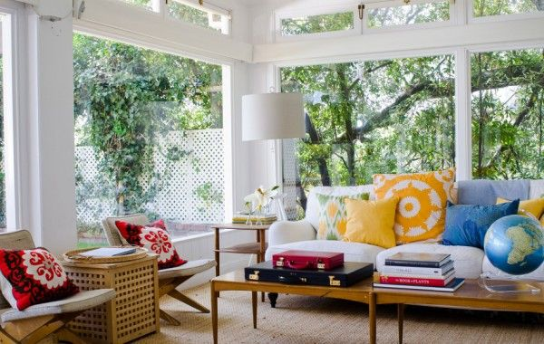 upholsterd chair, sunroom | ... Sunroom Design With Huge Glass Windows And Doors: Bright pillows and wood accents
