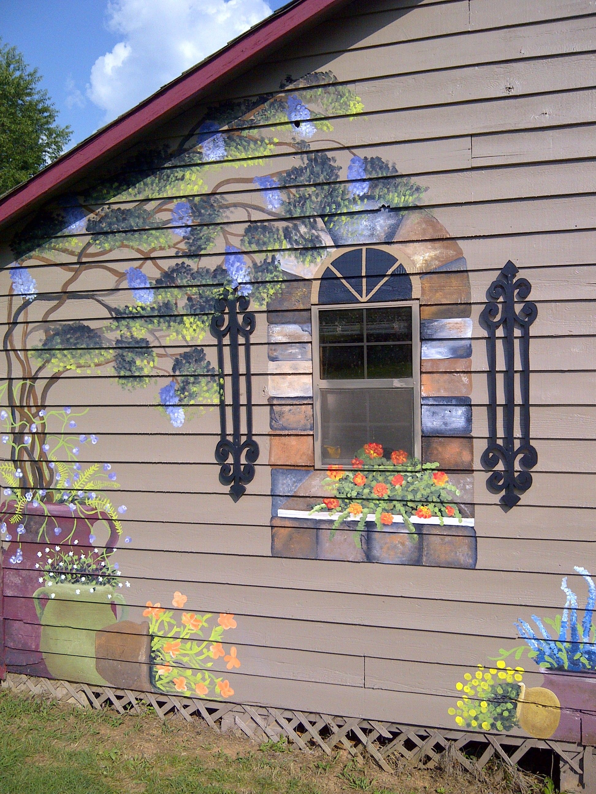 I even made those shutters out of wood and painted them to look like iron!!!  This is in Huntsville AL www.adornedmurals.com