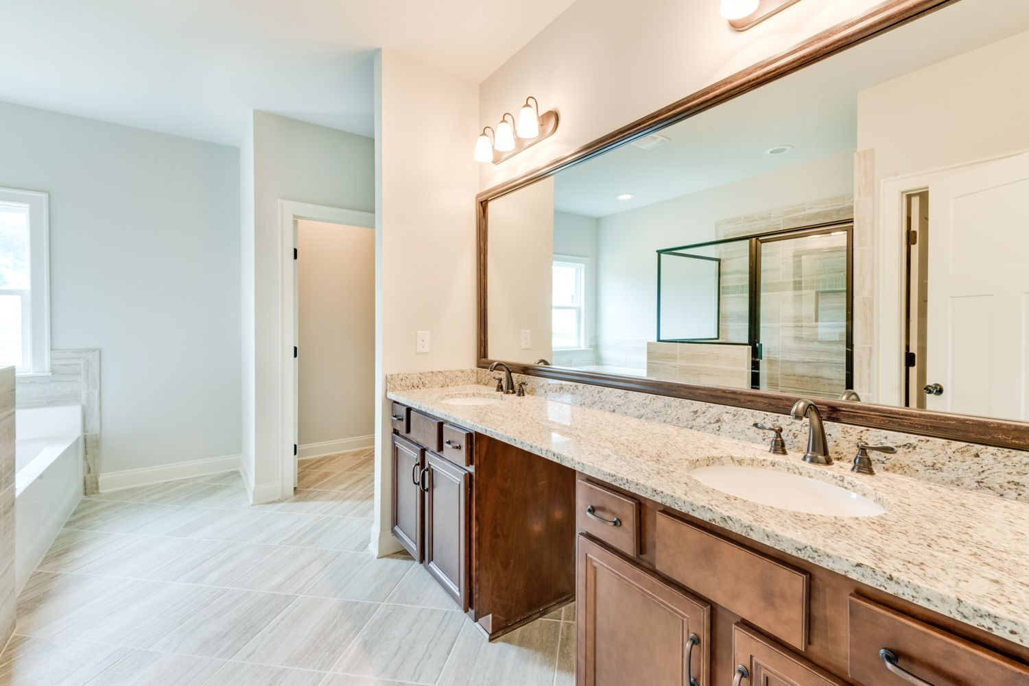 This Master Bathroom Has A Long Double Vanity With A Framed Mirror