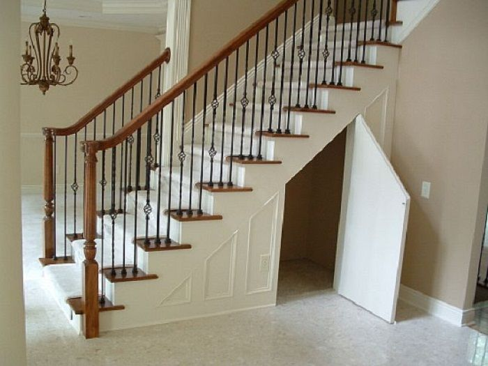Maximizing small spaces under the stairs storage maximize small space stair storage and - Small space staircase image ...