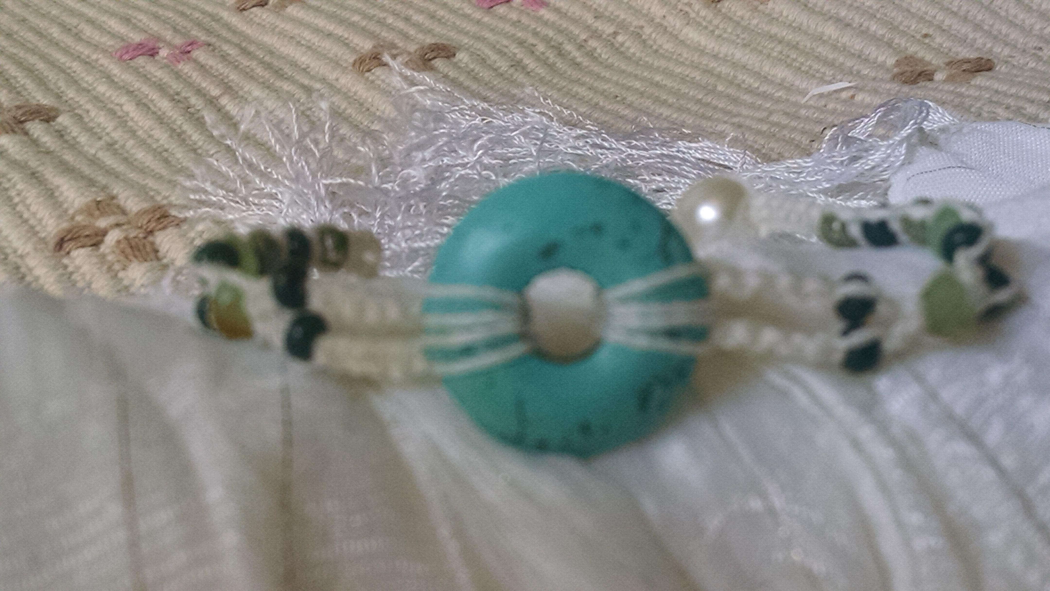 pulseira macrame branco com pedra azul turquesa
