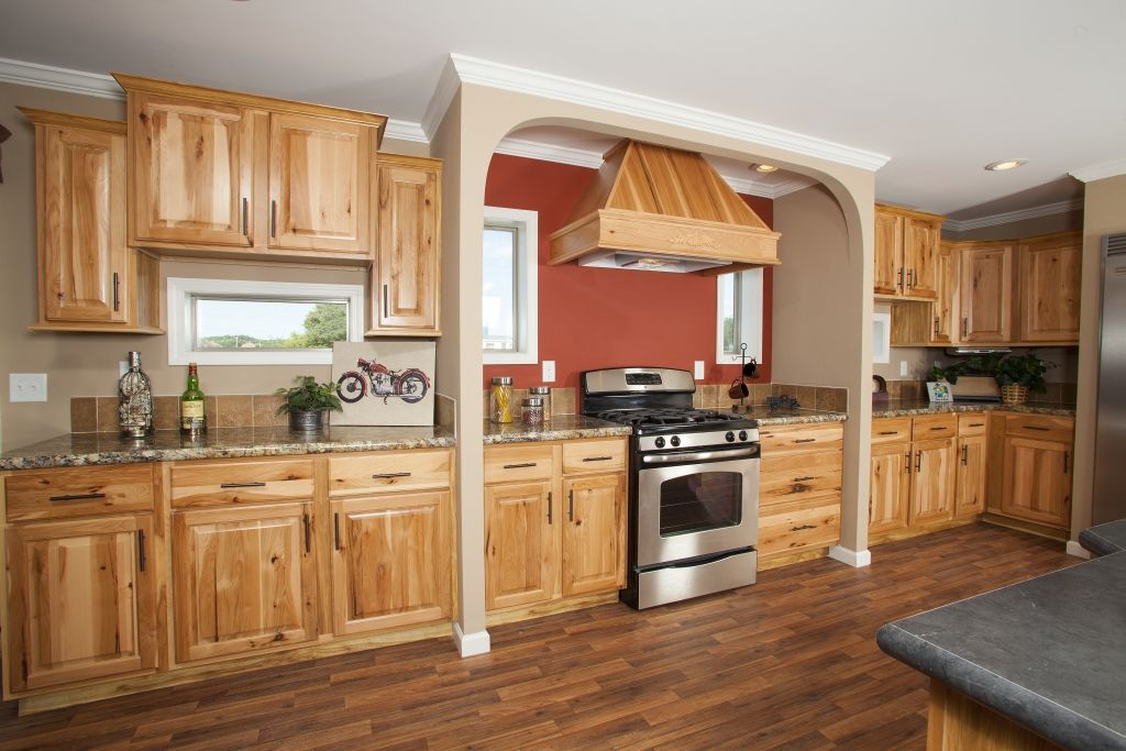 Honey E Hickory Cupboards Using Orange Paint Color With Wood Cabinetry