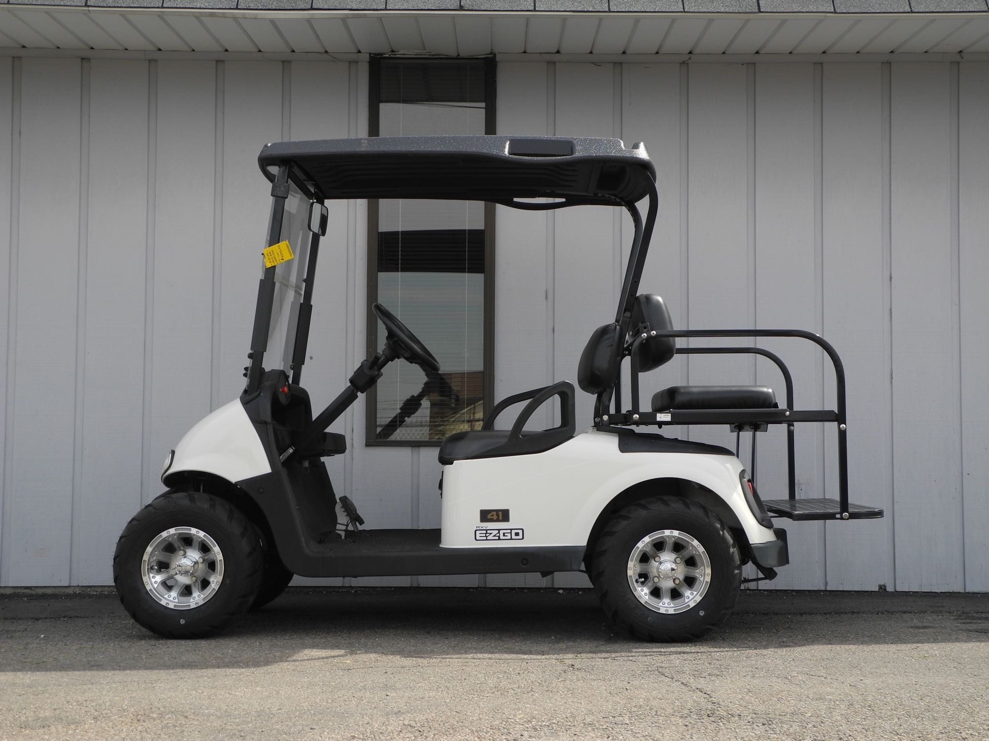 This 2010 E-Z-GO RXV electric golf car is street ready with premium Battery Powered Golf Carts Ez Go Seat on ez go golf carts chargers, ez golf cart batteries, ez go powerwise battery charger, 36 volt battery, forklift battery, trojan t-105 6v battery, ez go bike battery, ez go panama city,