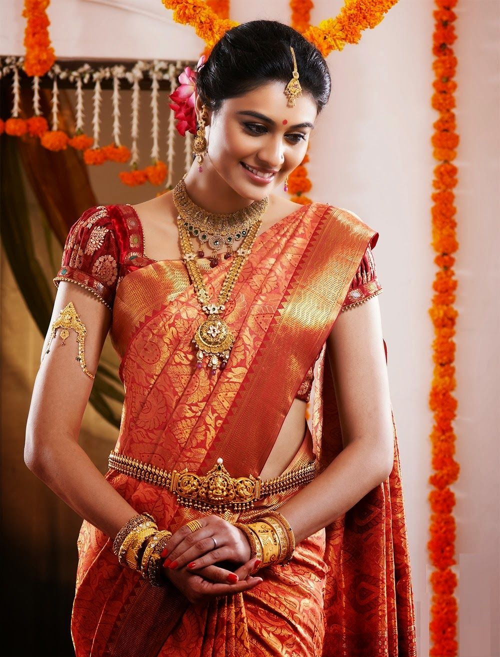 South Indian Bride in Red and Orange Saree South indian