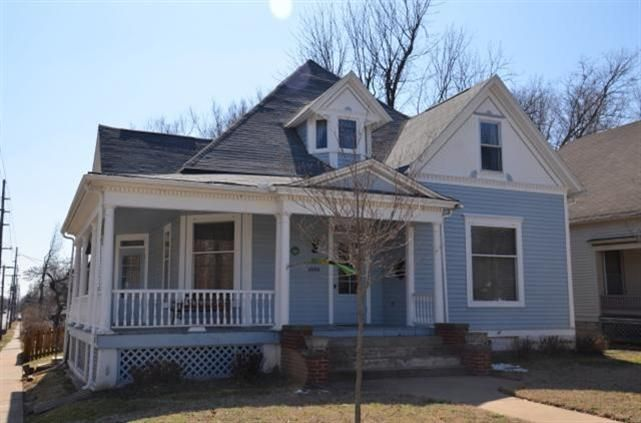 OPEN HOUSE TODAY 4/7/13 2-4pm!!!  A MUST SEE!!! Robert E. Williams House, built in 1902 as per original paperwork.  Over 100 year old Victorian has only had 4 owners in it's lifetime.  There is so much history for this property, original abstract title work, skeleton keys, magazine articles just to name a few.  You will love the original pocket doors with hardware and all the woodwork detail.  Home boast just under 2800 sq. ft. 11 ft ceilings, lots of storage, large wrap around porch and…