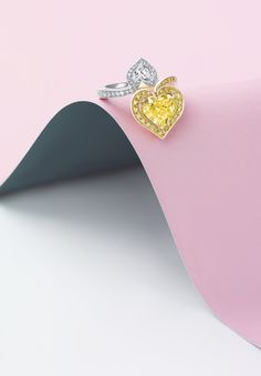 Boodles Gemini ring with a three carat fancy intense yellow heart-shaped diamond surrounded by yellow diamonds and coupled with a smaller, white heart-shaped diamond