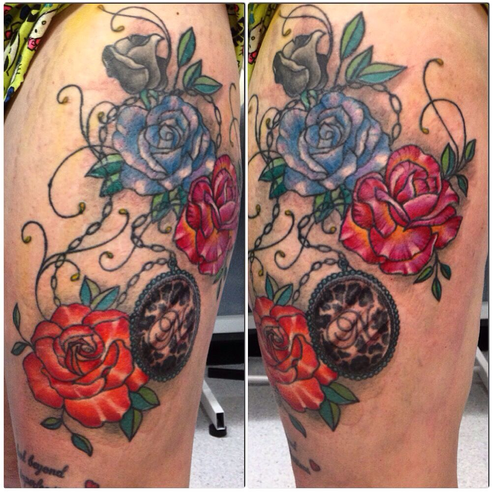 Roses and medal on chain tattoo by Susy at Wallington Tattoo