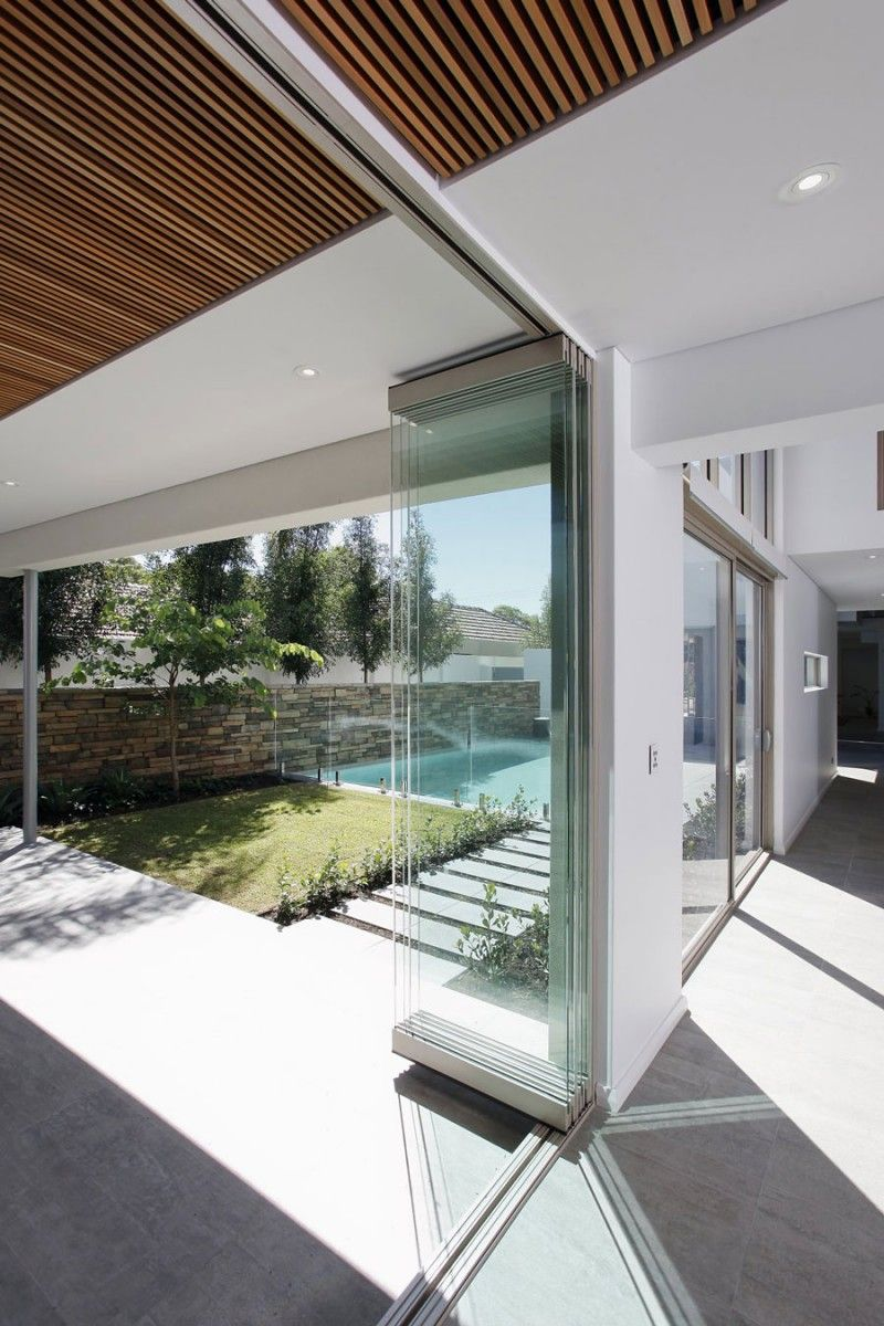 Open plan living space completed with double height living for Floor to ceiling folding glass doors