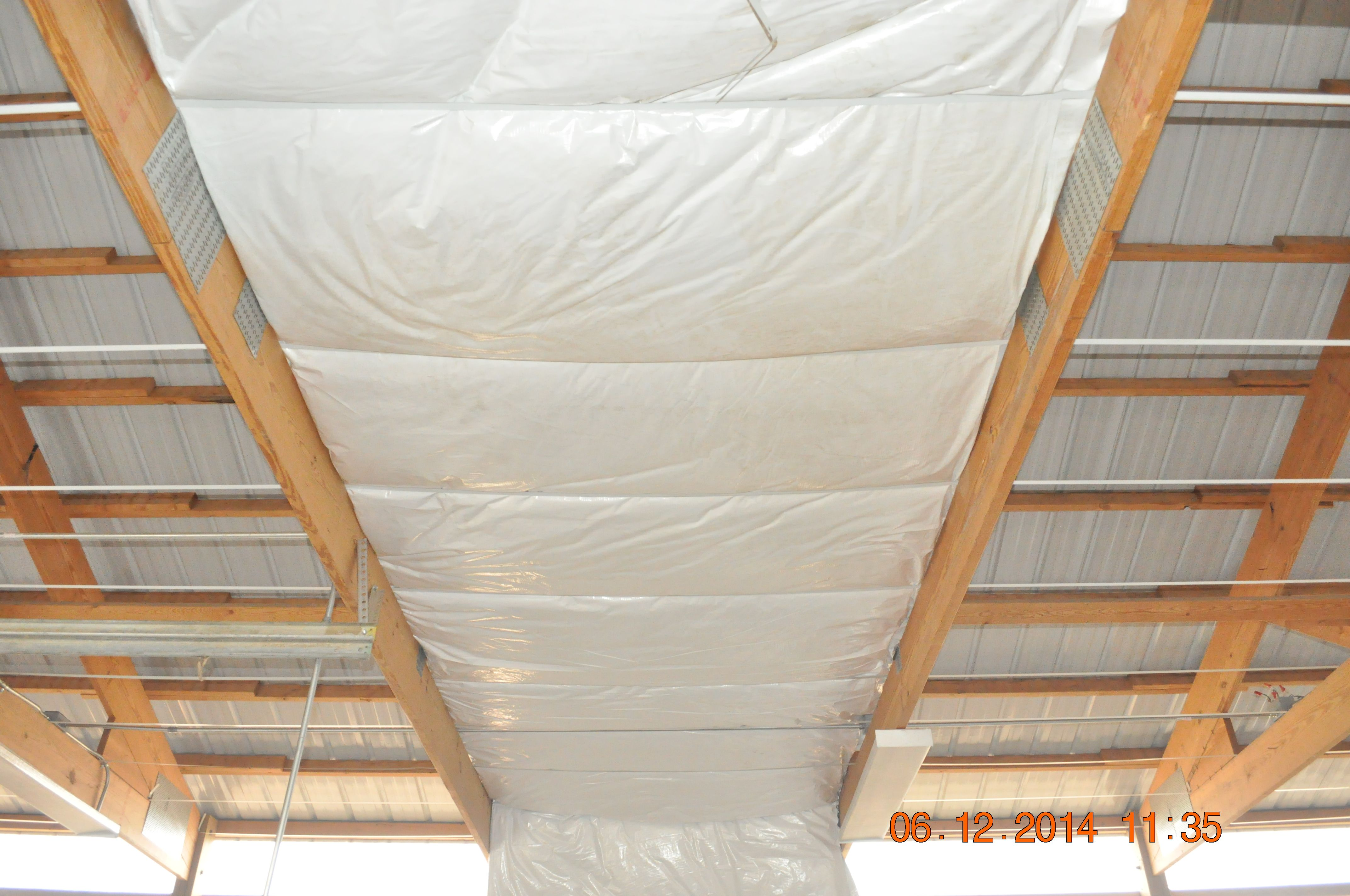 Pole Building Insulation Installed At The Bottom Of The Rafters