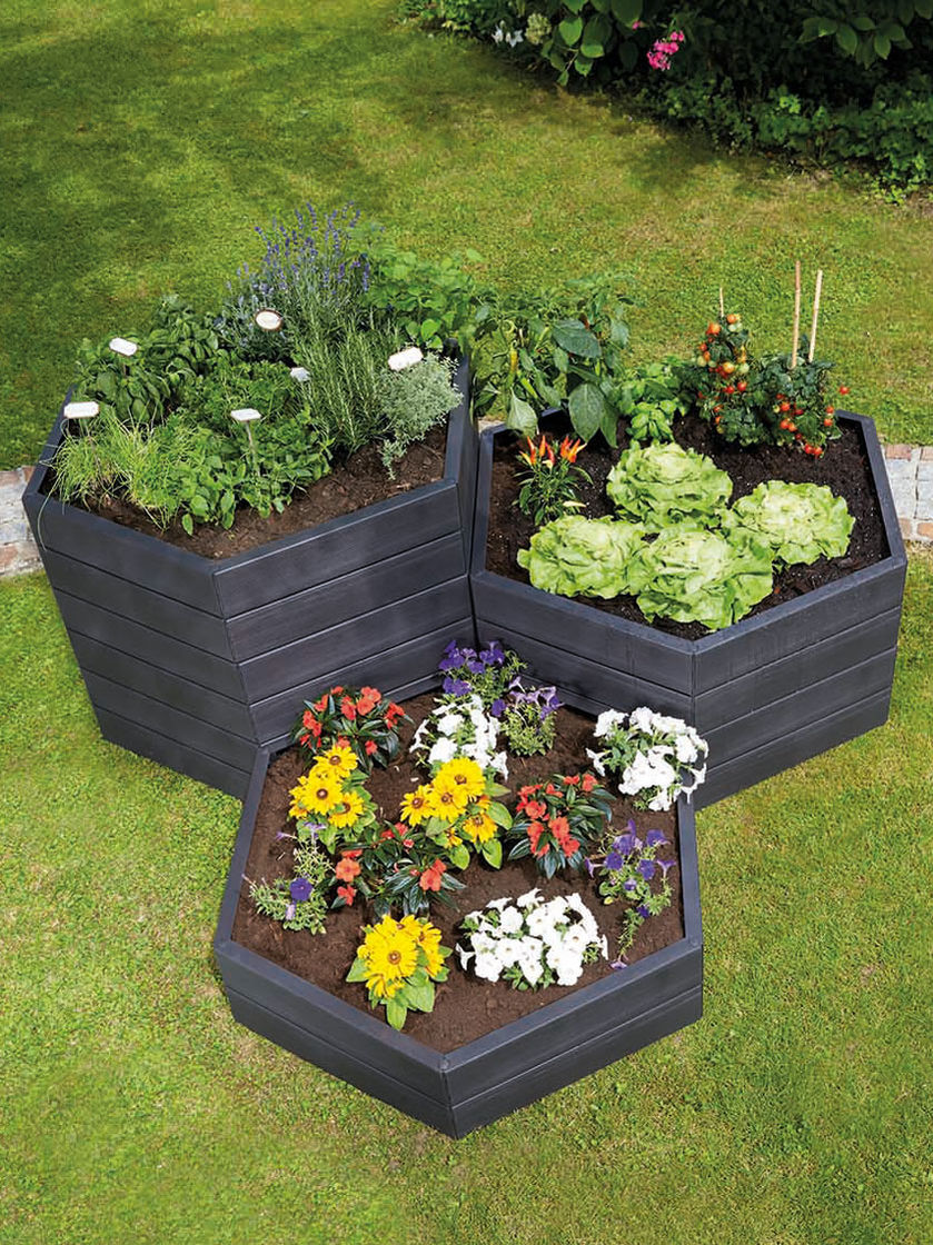 Exaco Hexagonal Raised Garden Bed Planter   Gardener's Supply is part of Garden beds, Diy raised garden, Raised garden, Watering raised garden beds, Wooden garden planters, Garden bed layout - 2  long by 10  high panels  This plastic bed has a wooden texture and is UV and moistureresistant