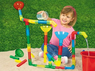 "Waterway Pipe Builders - Set of 25    With our fun-filled Pipe Builders, children can create twisting, turning constructions  that are perfect for water play! You get 23 slide-together pieces & 2 big funnels...children just pour water into their structures—and watch as it flows through the translucent pipes! 25 plastic pieces; longest is 5"".  HH886 • $19.95"