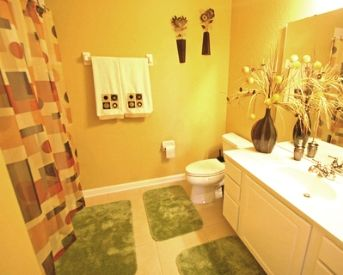 this site has a few color combos for a mustard themed bathroom. i