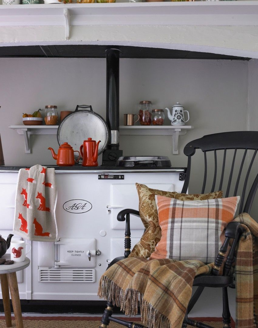 Love the Foxes in this Cosy country kitchen with white Aga