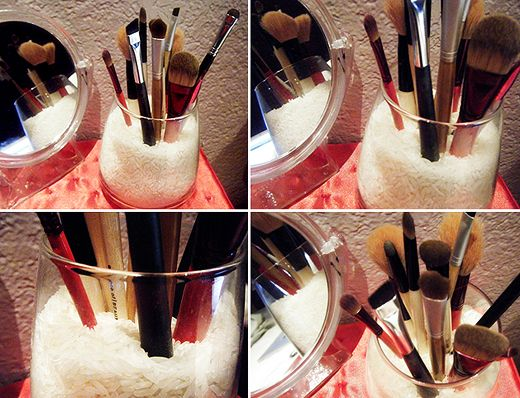 use a small vase and beads or rice to hold brushes