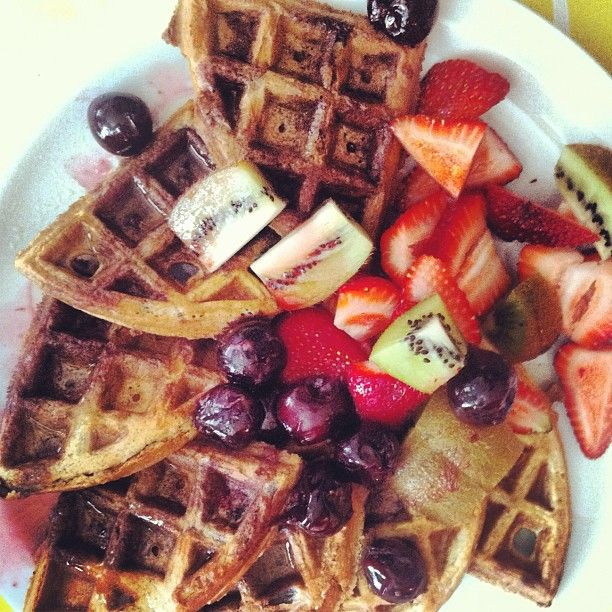 Paleo Waffles drizzled in cherry juice and fresh fruit.