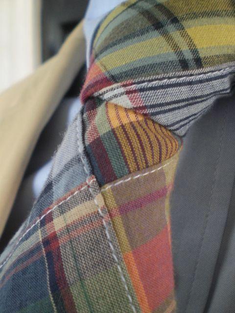 Plaid tie. Detail stitching...