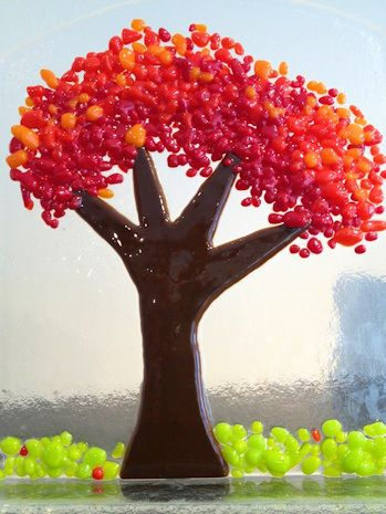 These amazing hand made glass trees would make a great addition to your mantel or desk! Each piece is signed by the artist who resides in Ohio. They make me happy just looking at them.