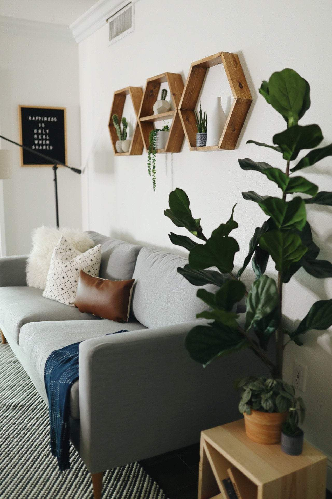 Ways To Style An Empty Wall In 2020 Above Couch Decor Living Room Shelves Couch Decor