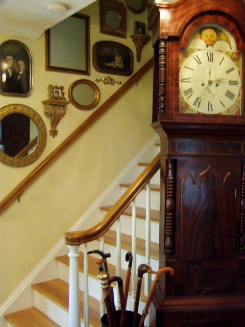 I love the mirrors and pictures going up the stair walls ...