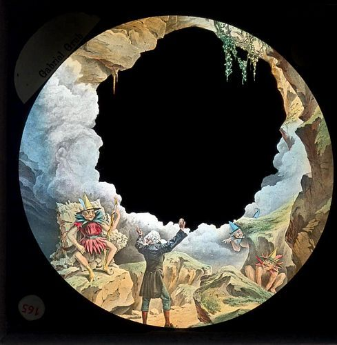 Slide from a lantern narrative adapting Dickens's 'Gabriel Grub.'  This slide is an outline image allowing various other images to appear and disappear in the blank space to depict the changing visions shown to Gabriel by the goblin king.