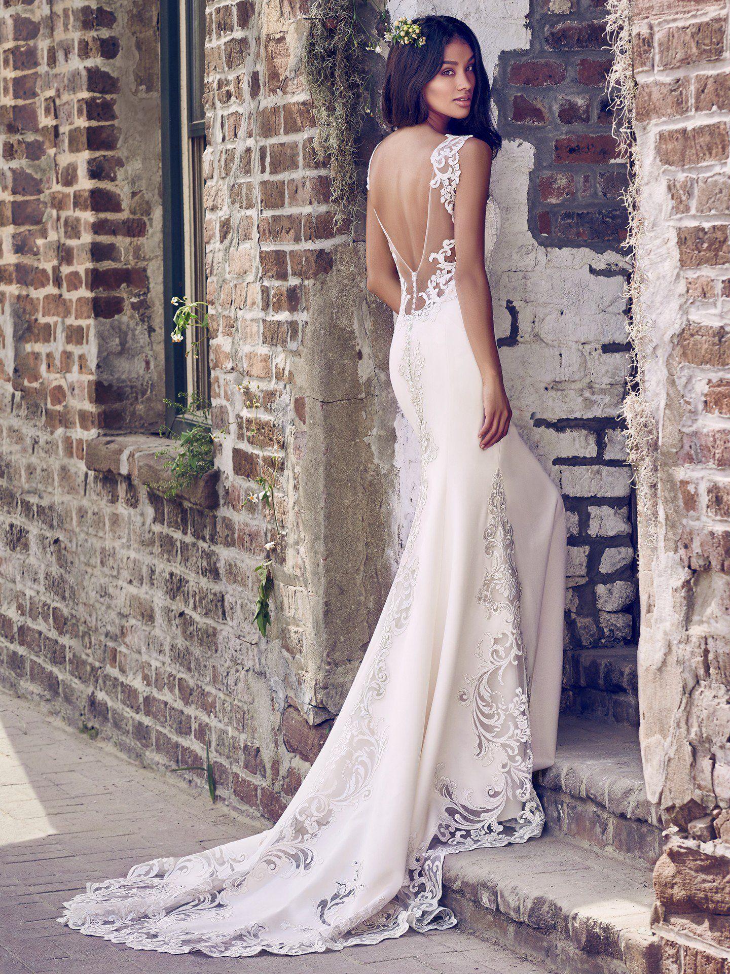 4b9210f6 Maggie Sottero - VERONICA, Embroidered lace motifs adorn the illusion  cutout train, illusion scoop back, illusion straps, and illusion V-neckline  in this ...