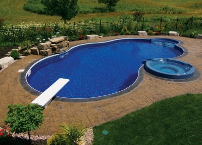 Spacious Vinyl Liner Pool With Diving Board And Attached Spa