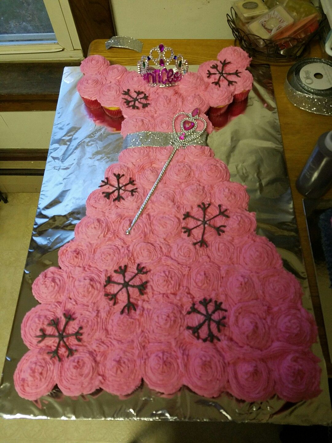 Snowflake pink princess cupcake cake for first birthday party