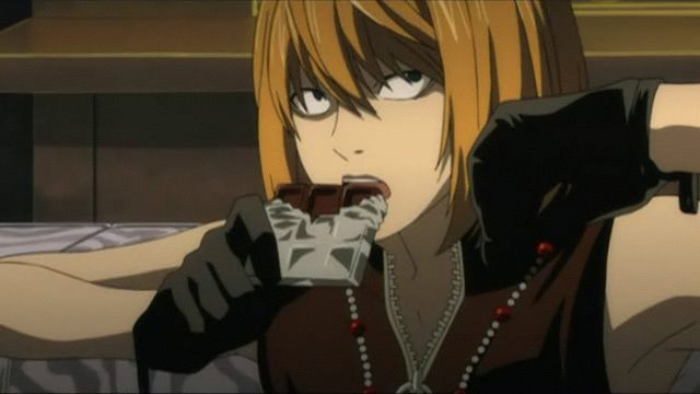 This is Mello before he got the scar (and of course he is eating chocolate)