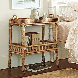 nspired by a mid-century antique, this chic little side cart pays homage to the textural beauty of handwoven rattan. Set atop brass casters, it glides across the room with ease. Unexpected as a bedside table; perfection as a mini bar in the living or dining room. Spring 2012