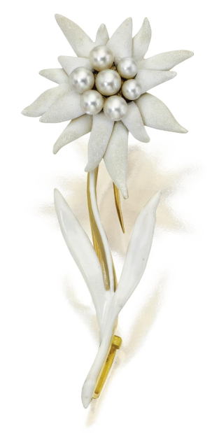 Gold, Pearl and Enamel 'Edelweiss' Brooch, Tiffany & Co., Circa 1880. The small flower set in the centre with pearls, the petals and stem applied with white enamel, signed Tiffany & Co. #Tiffany #Antique #brooch
