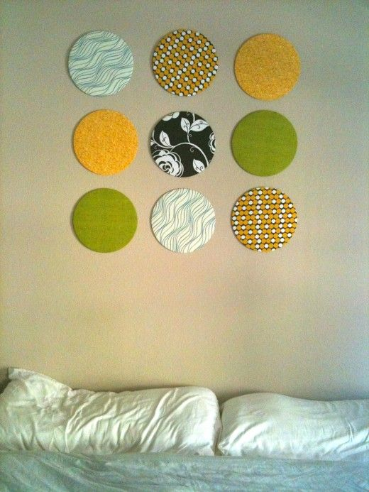 Use cake board circles and fabric, a little thread and some tacks ...