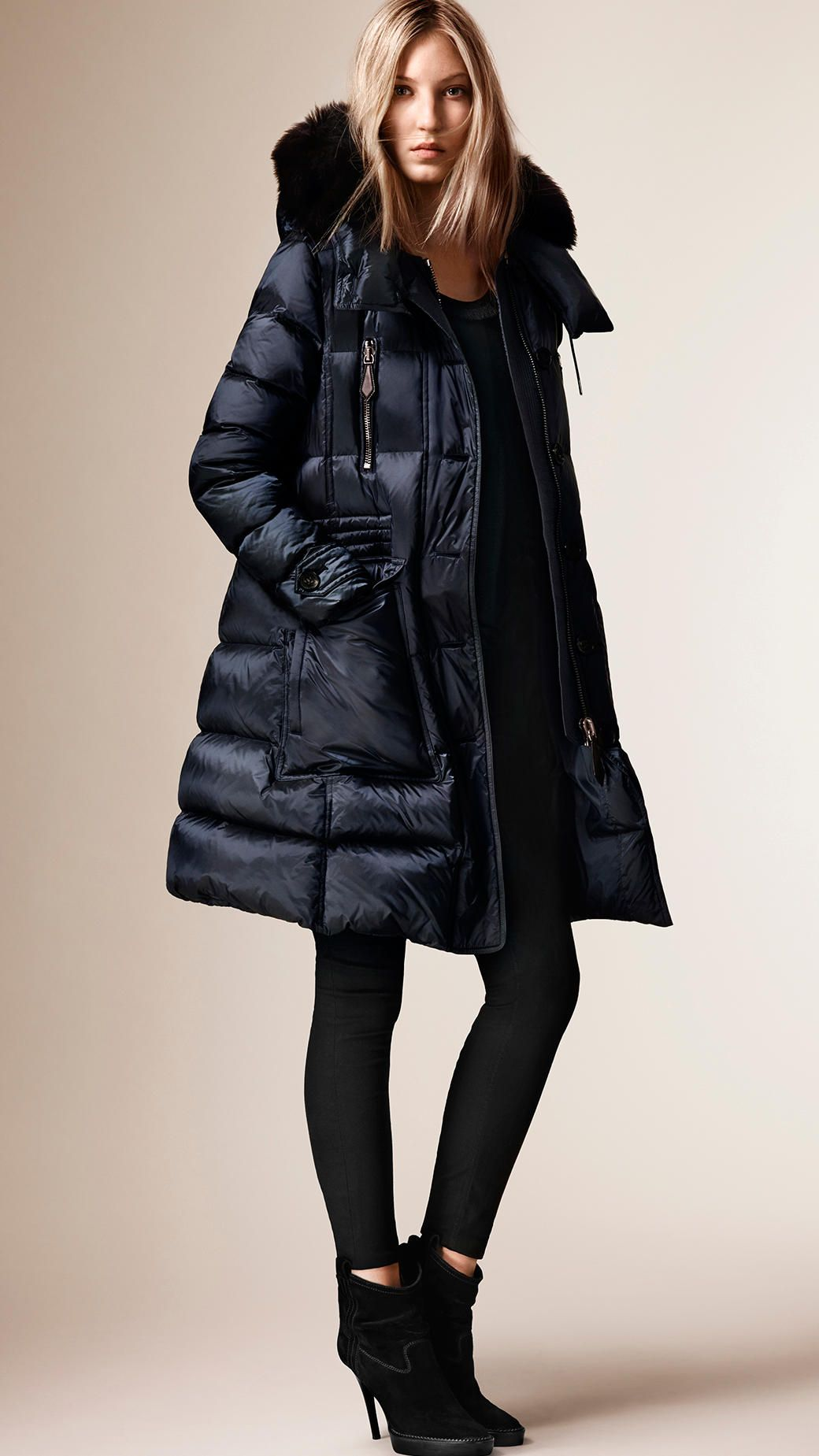 A showerproof downfilled puffer coat with a detachable