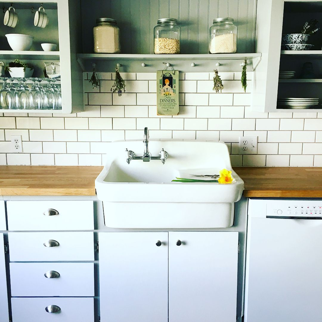 Farmhouse Kitchen With Vintage Apron Front Sink Subway Tile And