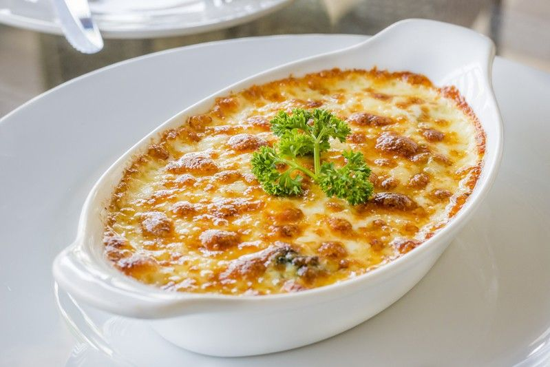 Spinaci gratinati con prosciutto e formaggio ricetta for Cucinare spinaci